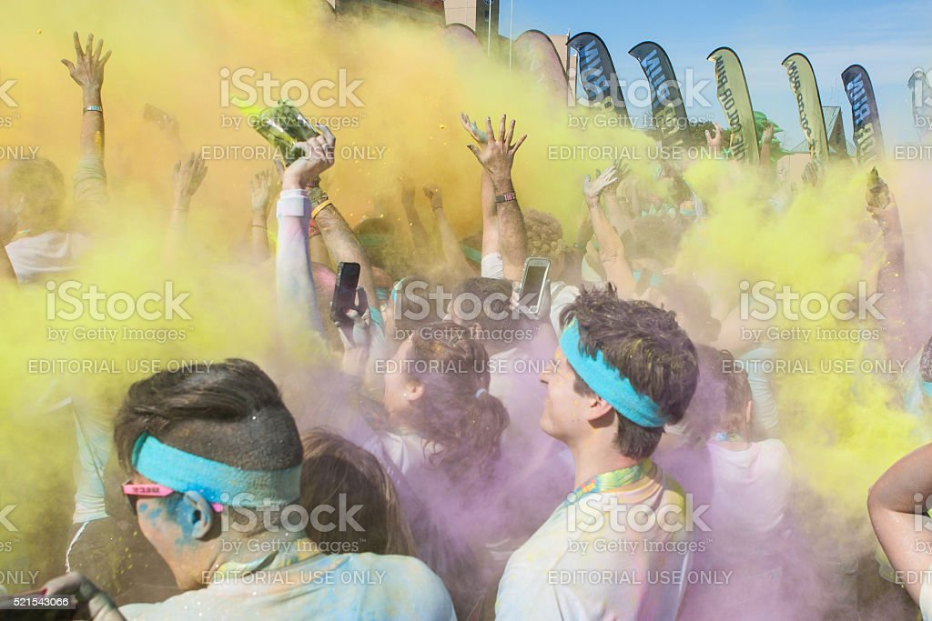 People Create Color Explosions With Colored Corn Starch Packets stock photo