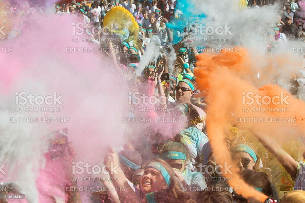 People Create Explosion Of Colors With Colored Corn Starch Packets stock photo