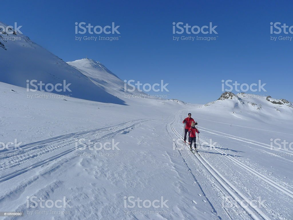 People cross country skiing stock photo