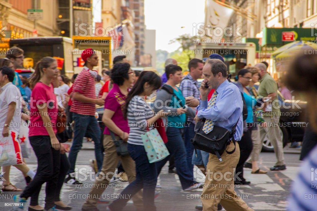 people crossing 43rd Street in New York City stock photo