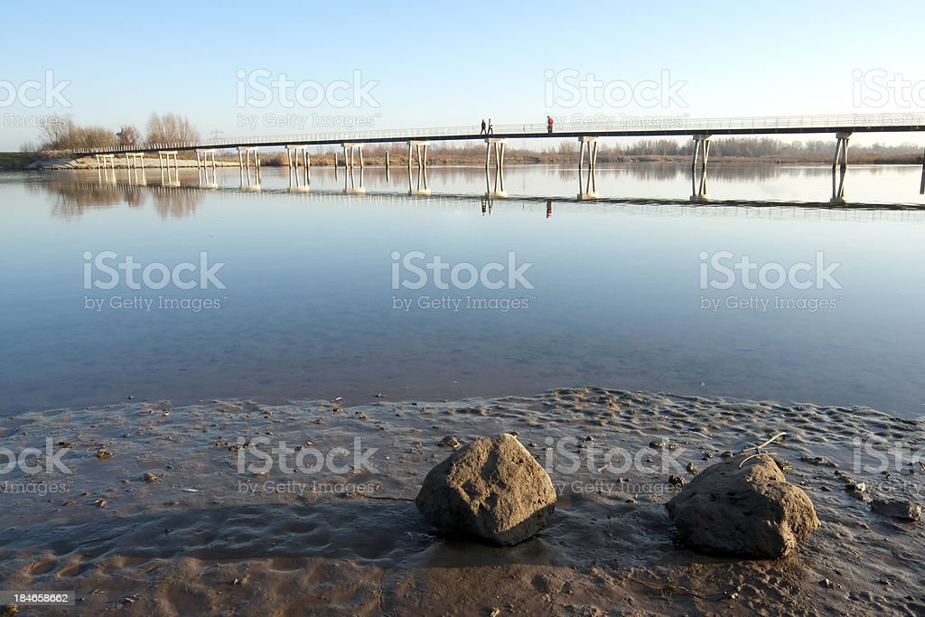 People crossing a bridge in the Biesbos stock photo