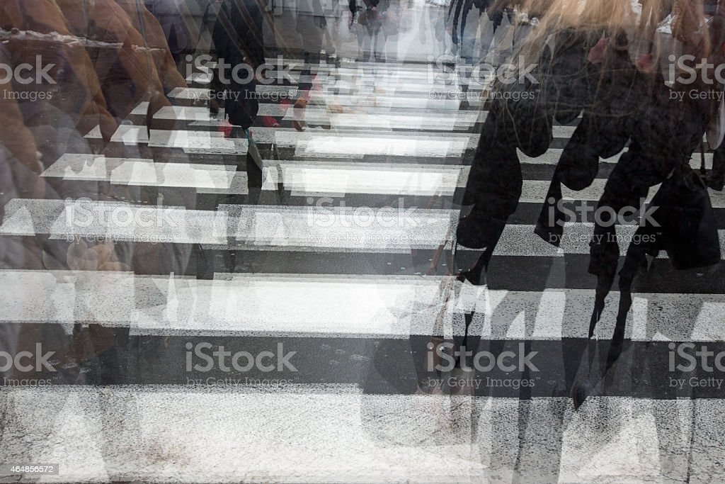 People crossing a road stock photo