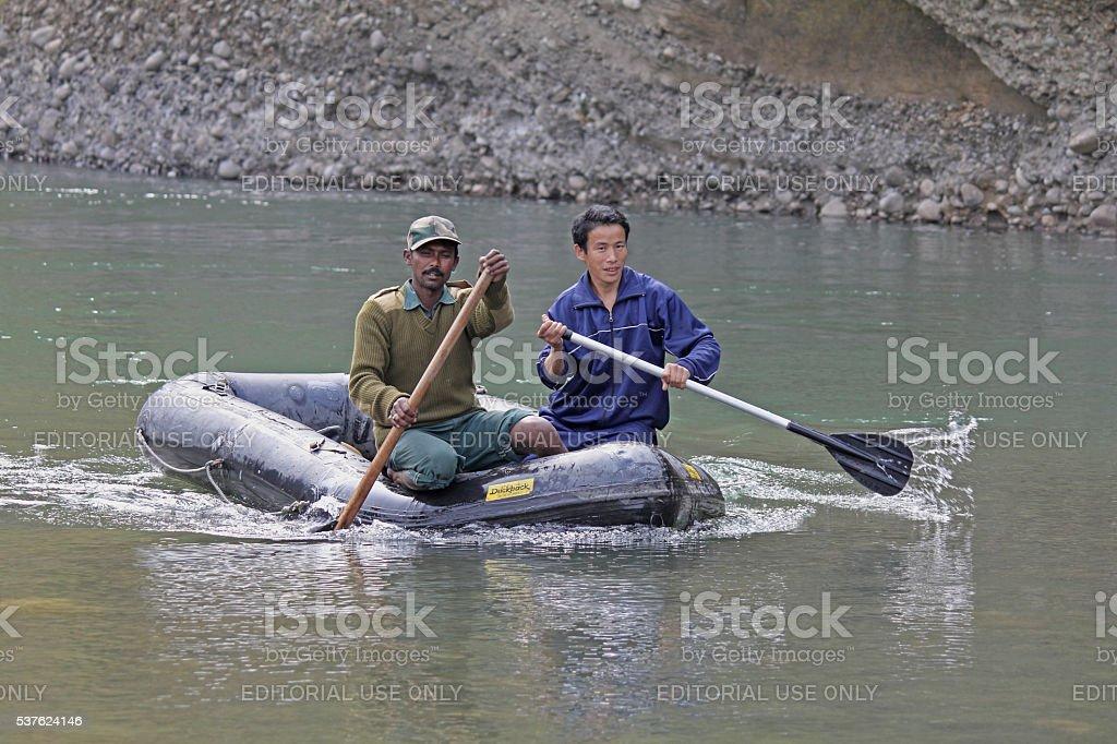 People Crossing Debang River stock photo