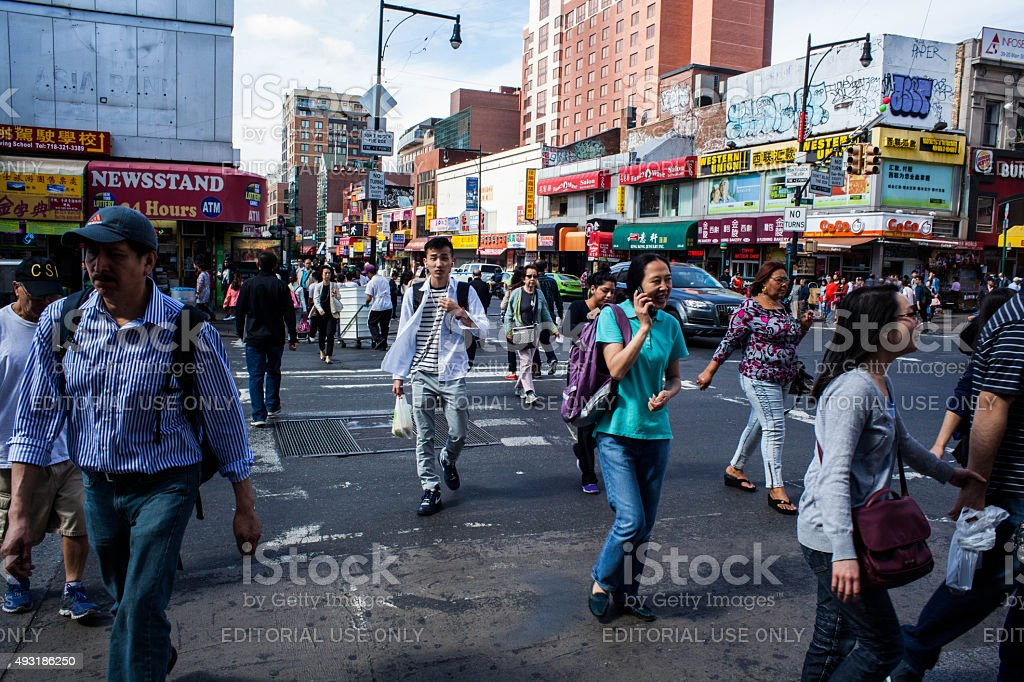 People crossing Main Street in Flushing Queens' Chinatown stock photo