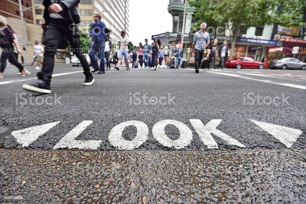 People crossing rainy street stock photo