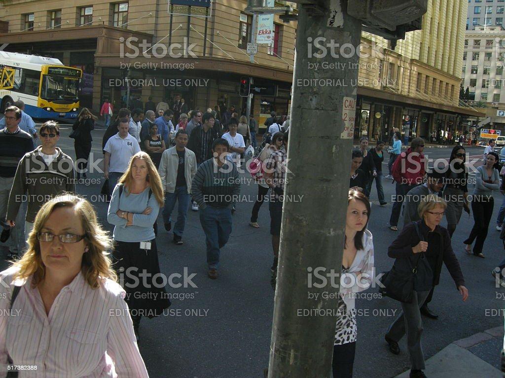 people crossing street in Brisbane city stock photo