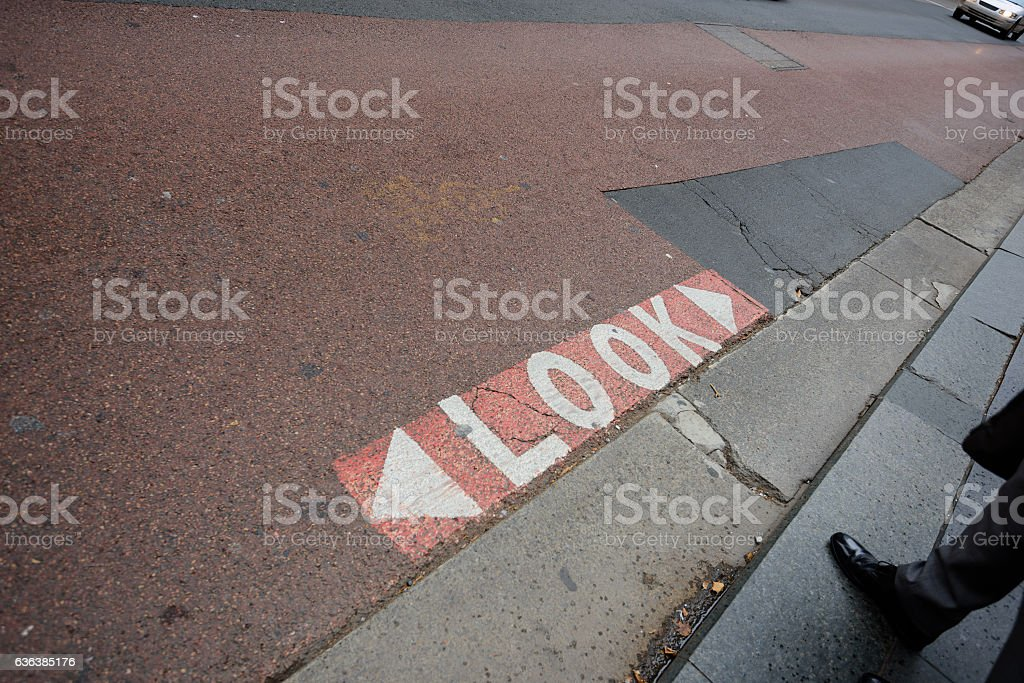 People crossing street in central Sydney, suit close up stock photo