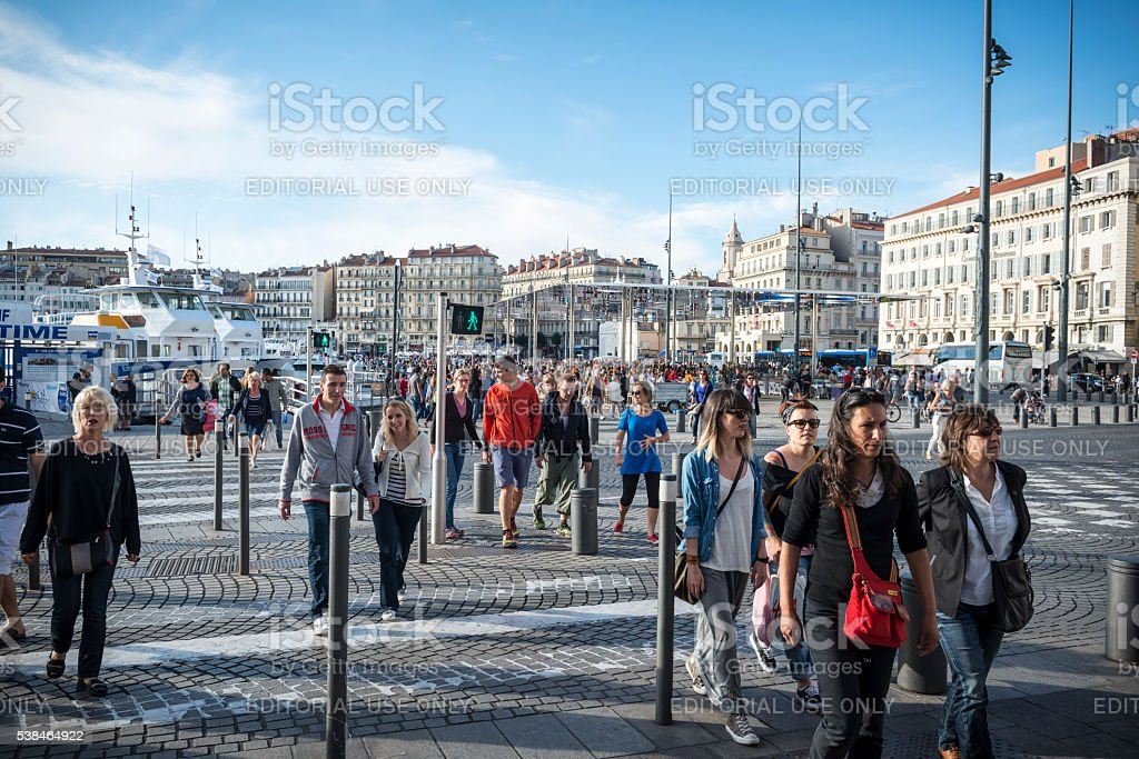 People crossing street in Marseille, France stock photo