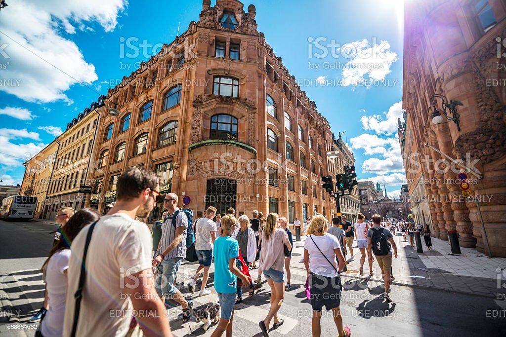 People crossing street in Stockholm, Sweden stock photo