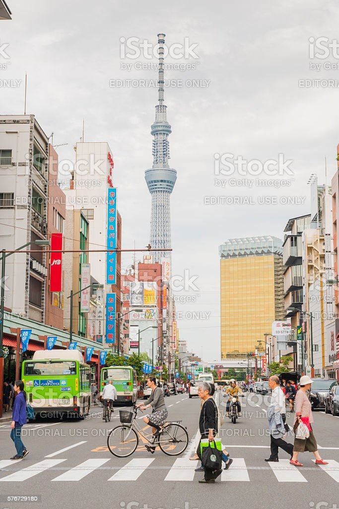 People Crossing Street in Urban Asakusa with Tokyo Skytree Japan stock photo