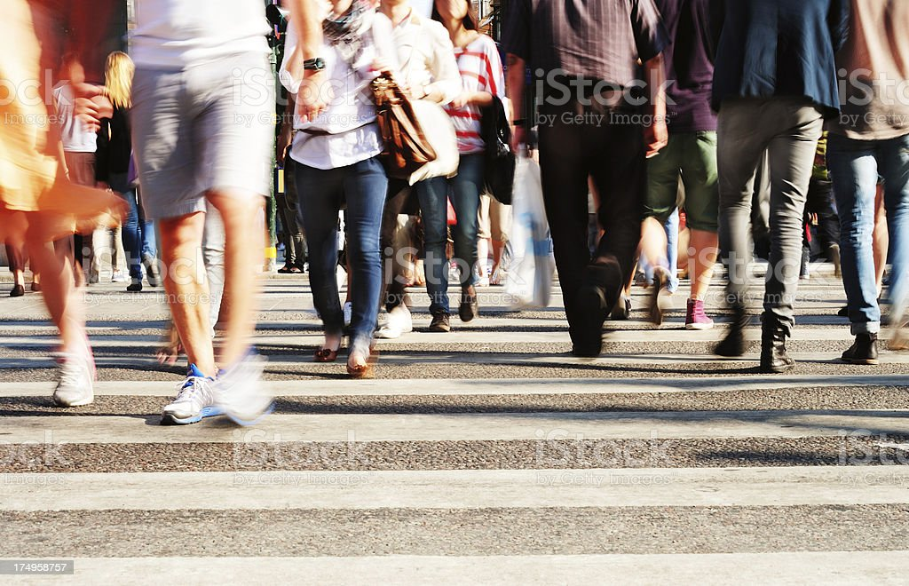 People crossing street, motion blur stock photo