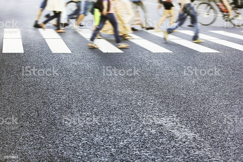 People crossing street, motion blur stock photo
