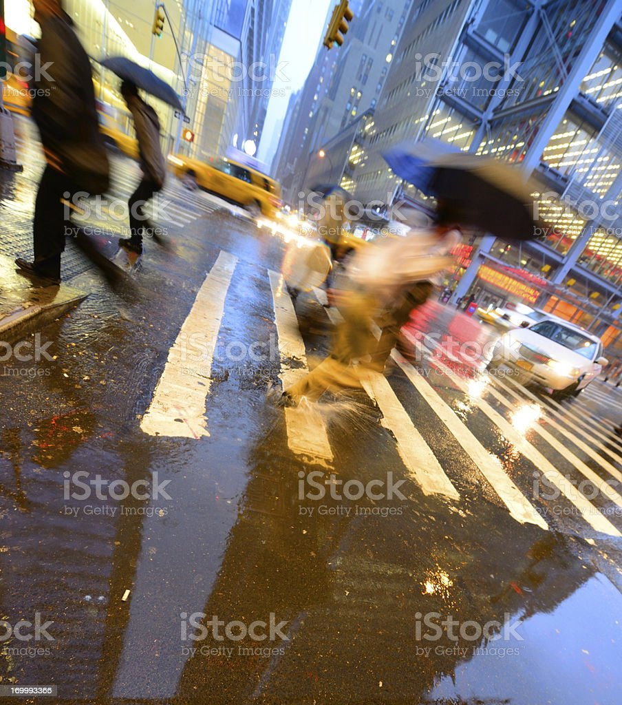 People crossing street on rain wet zebra x-ing, NYC royalty-free stock photo