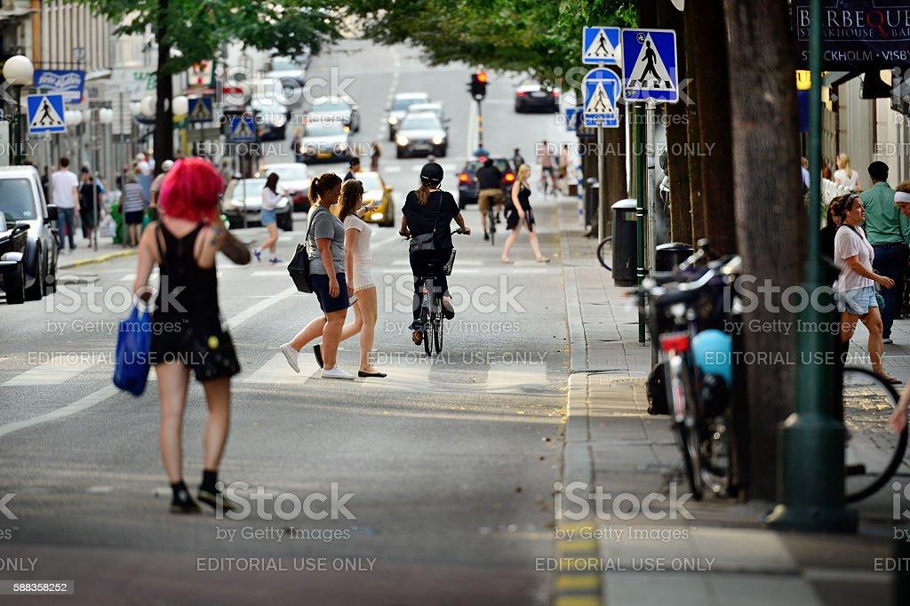 People crossing street stock photo