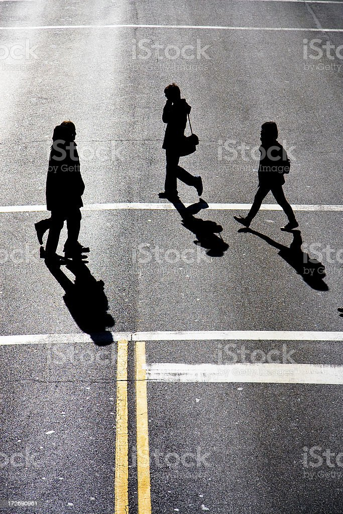 People crossing the road royalty-free stock photo