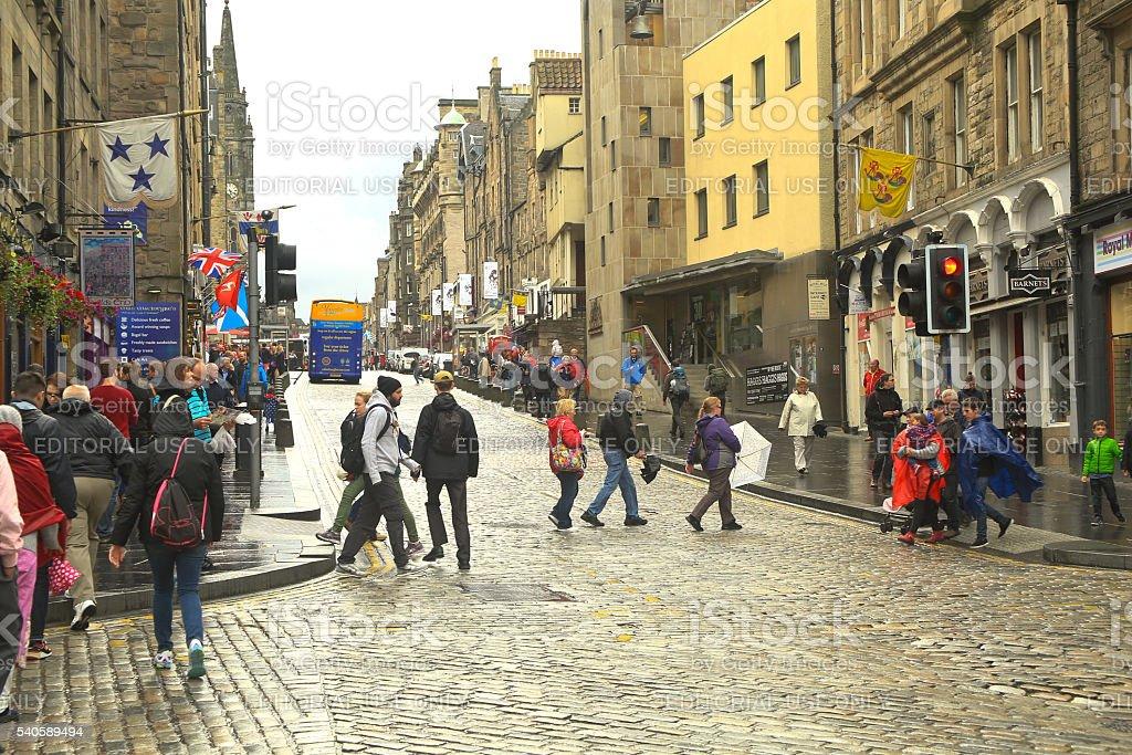 People Crossing the Royal Mile, Edinburgh, Scotland, UK. stock photo
