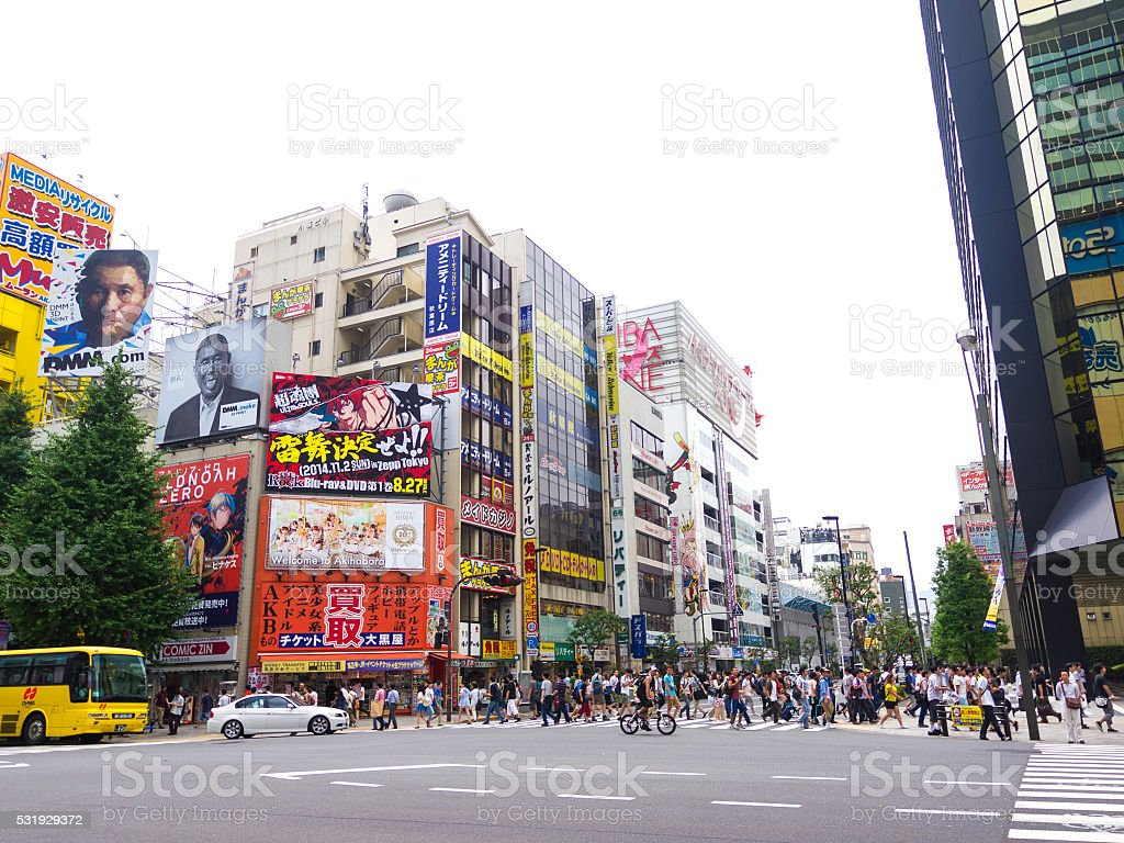 People crossing the street in Akihabara in Tokyo stock photo