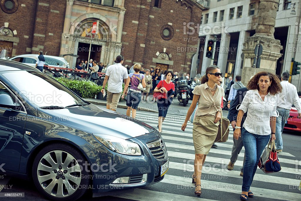 People crossing the street in MIlan royalty-free stock photo
