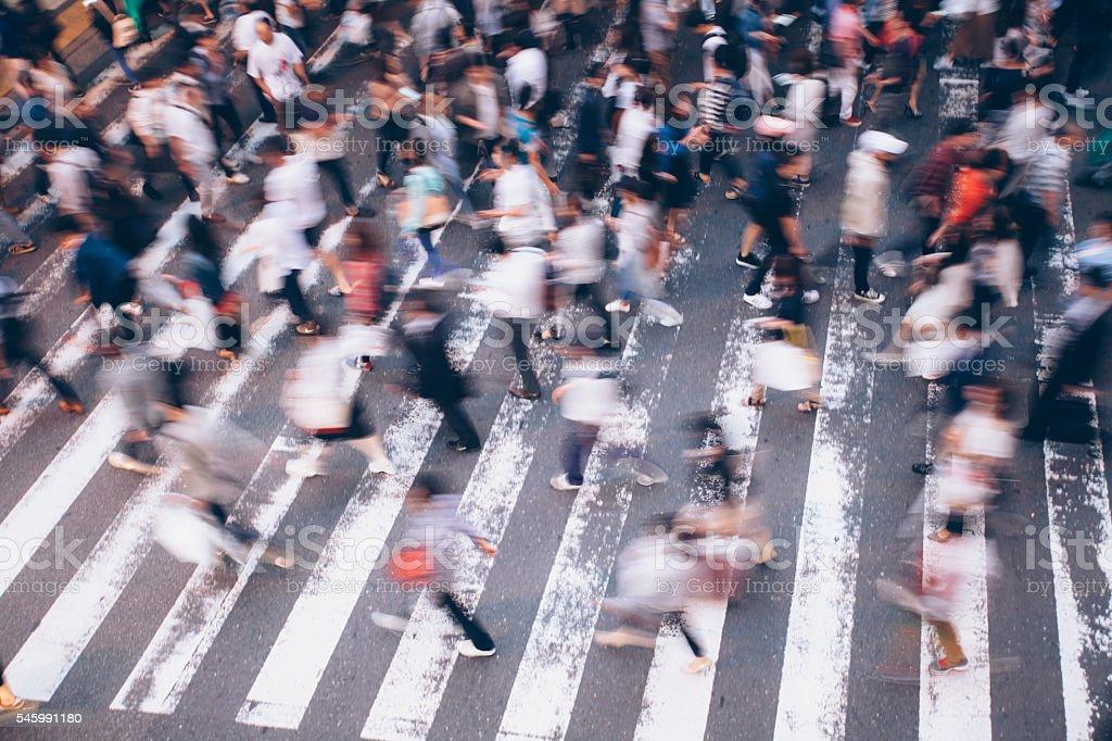 People crossing the street on walkway in Kyoto, Japan stock photo
