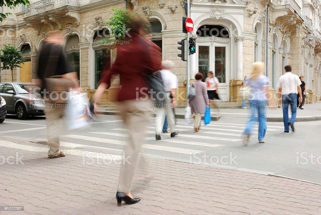 People Crossing the street on walkway royalty-free stock photo