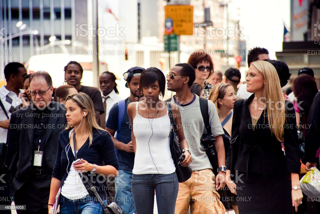 People crossing the street stock photo