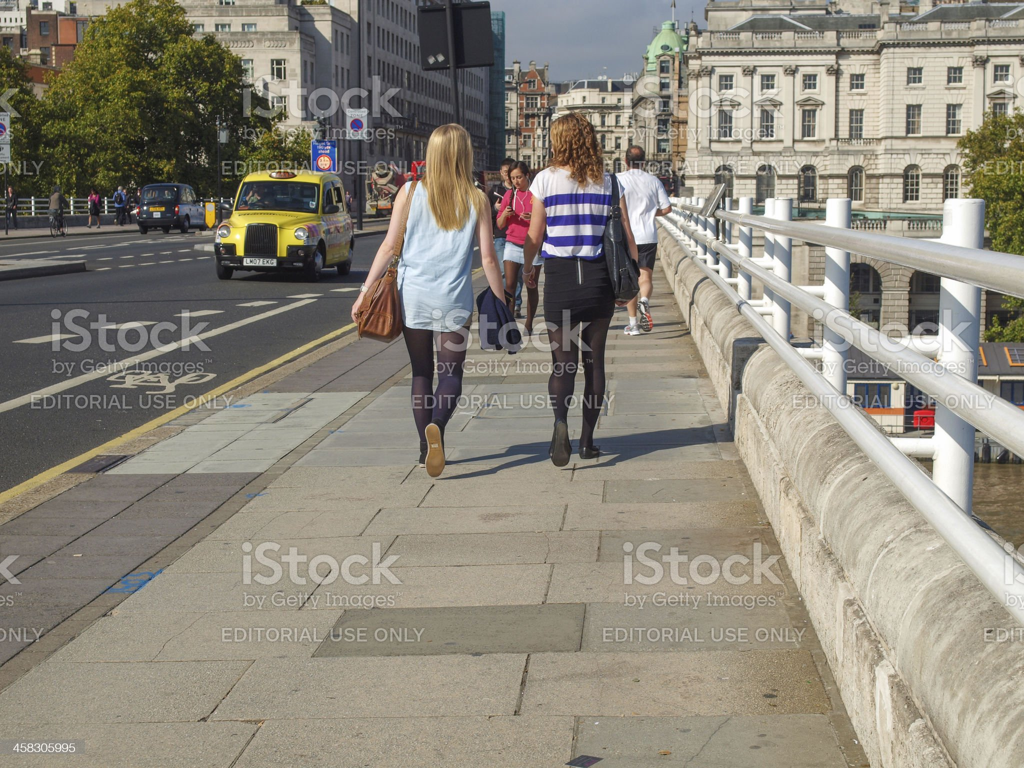 People crossing the Waterloo Bridge in central London royalty-free stock photo