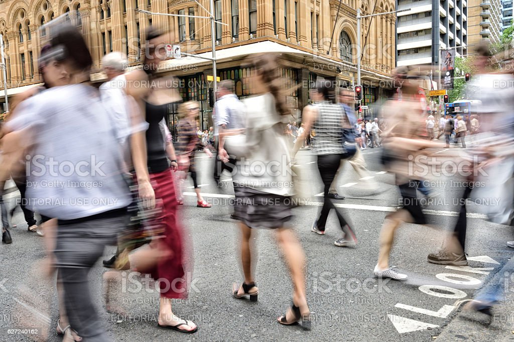 People crowd crossing street in central Sydney stock photo
