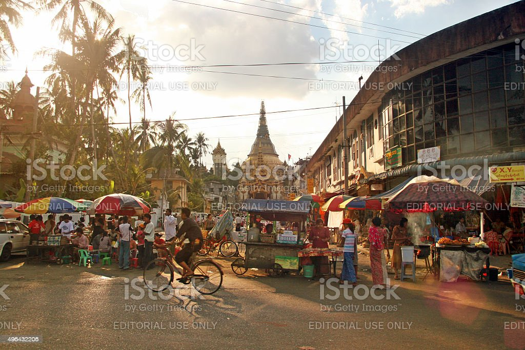 People crowding a street market in Yangon, Myanmar stock photo