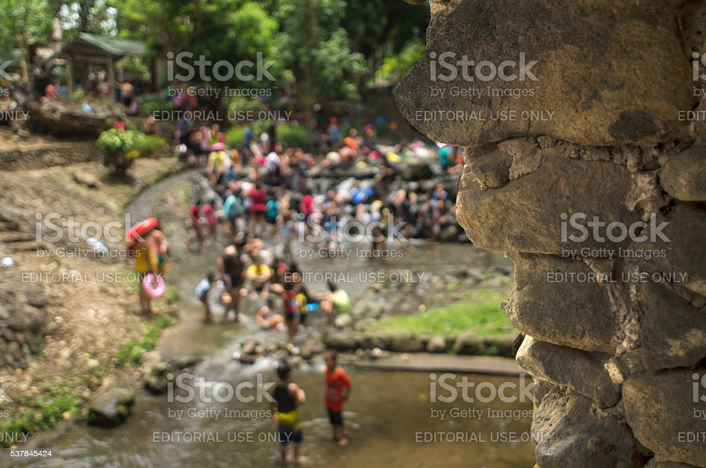 People crowding on cool river water on summer stock photo