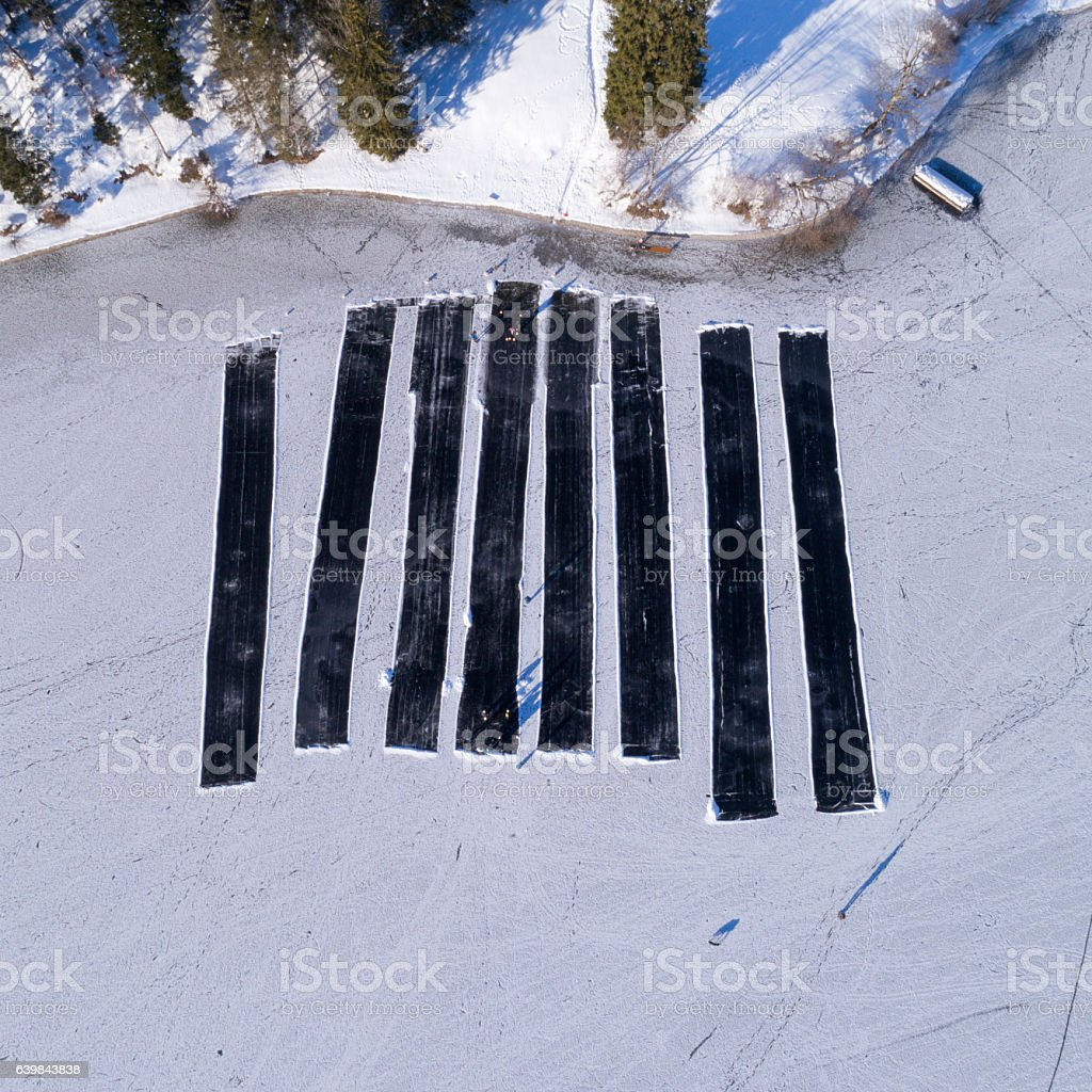People Curling, Eisstockschiessen on a frozen Lake, View from Above stock photo