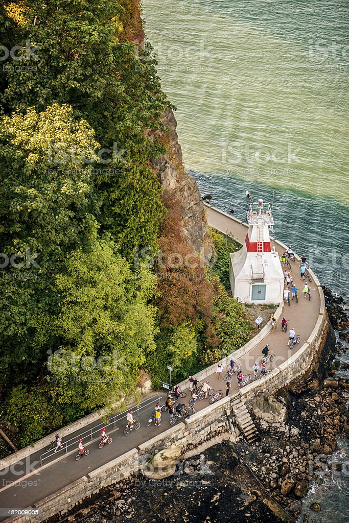 People cycling and jogging in Stanley Park, Vancouver stock photo
