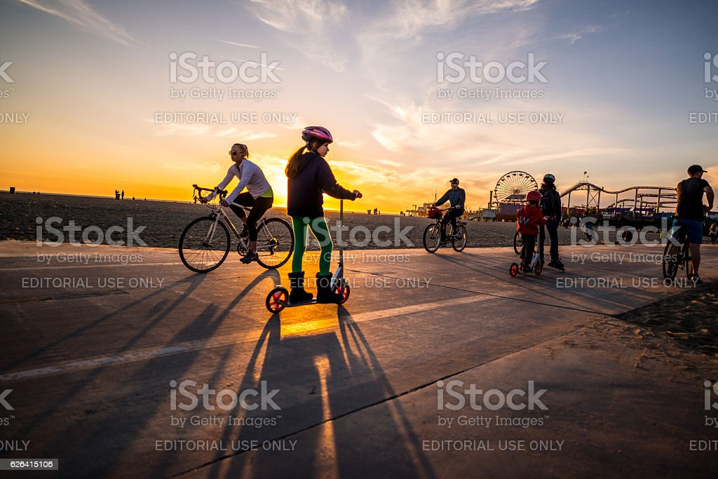 People cycling and jogging on Santa Monica beach, CA, USA stock photo