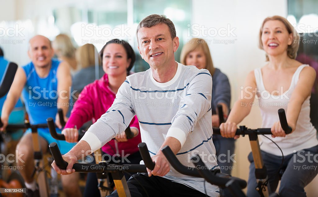 People cycling in a gym stock photo