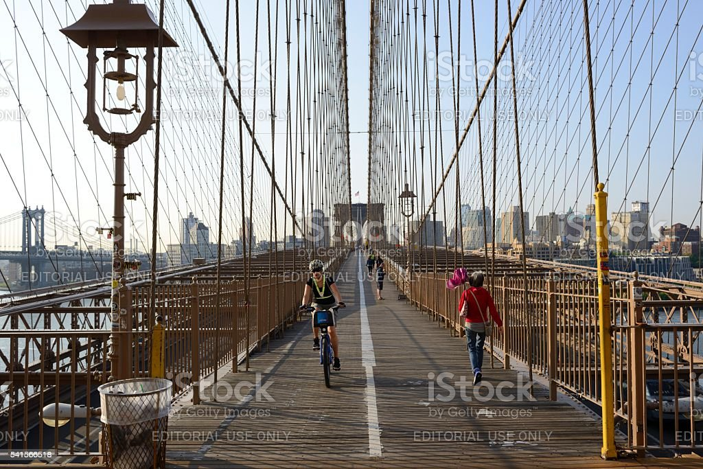 People cycling,walking and running on the Brooklyn Bridge stock photo