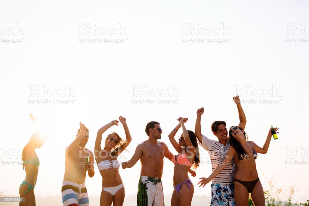 People dancing and partying in summer stock photo