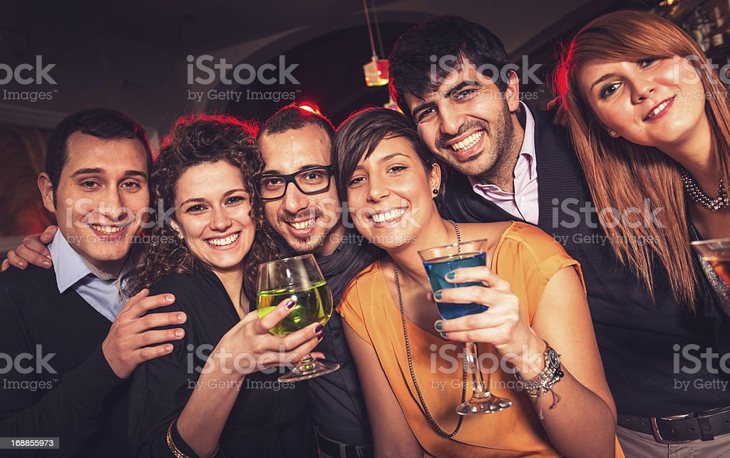 People dancing at disco royalty-free stock photo