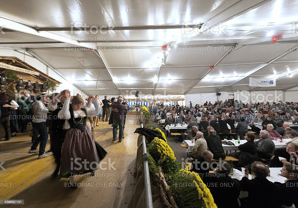 people dancing in entertainment tent at Aelplerfest, Lenk Switzerland royalty-free stock photo