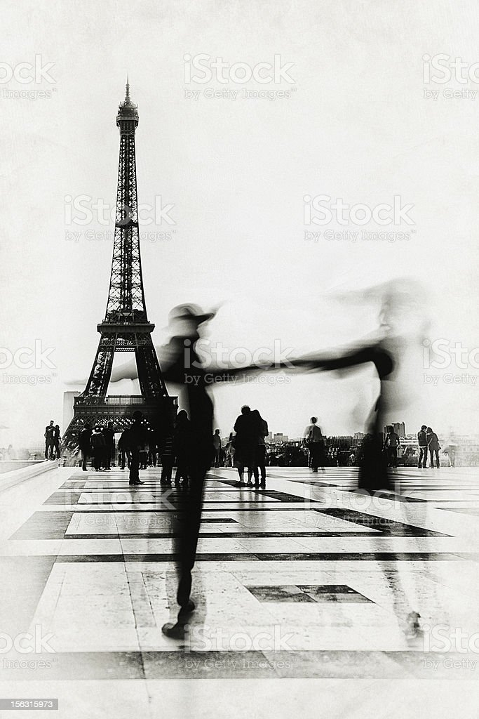 People dancing in front of Eiffel Tower stock photo