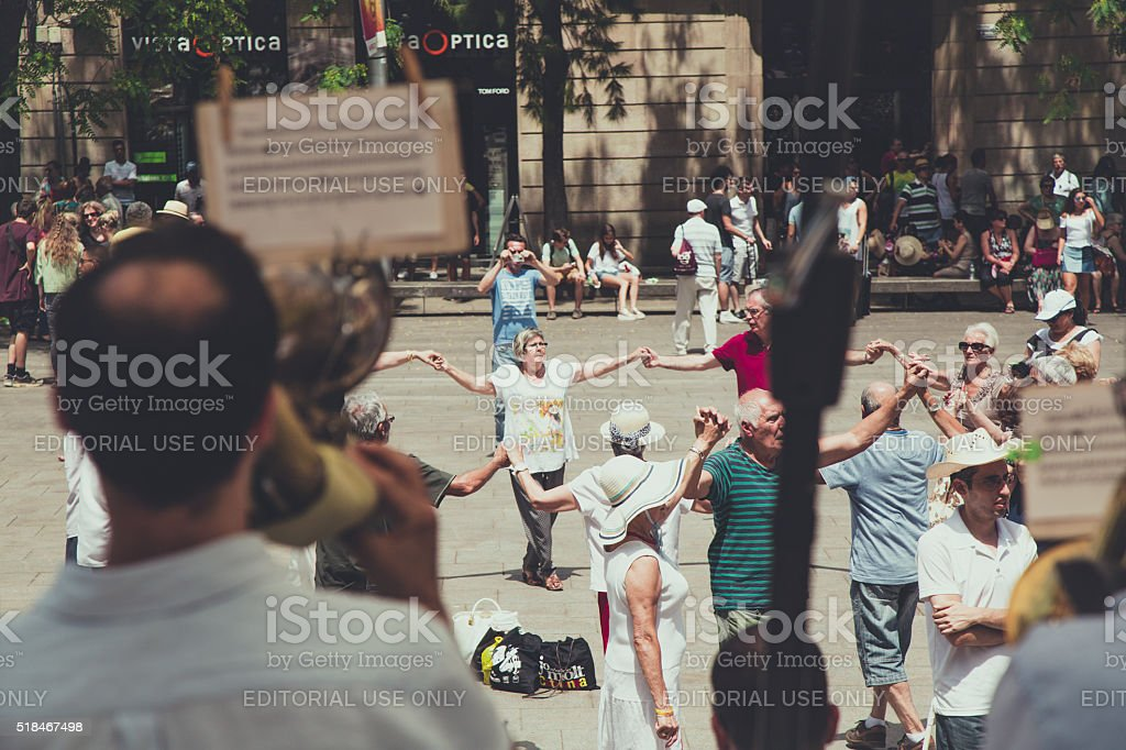 People dancing Sardana  dance under the The Cathedral of Barcelona stock photo