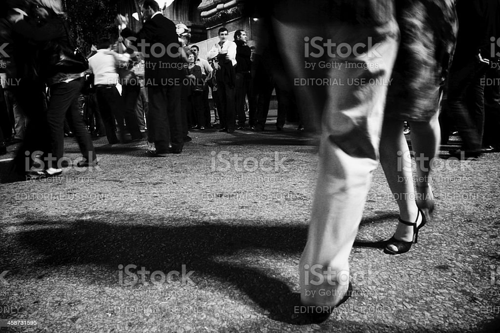 People dancing tango at the street in Montevideo at night royalty-free stock photo