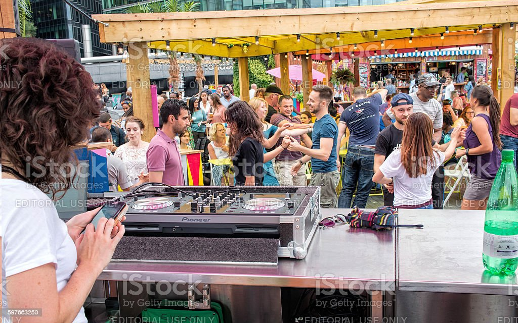 People dancing to music at public outdoor street festival. stock photo