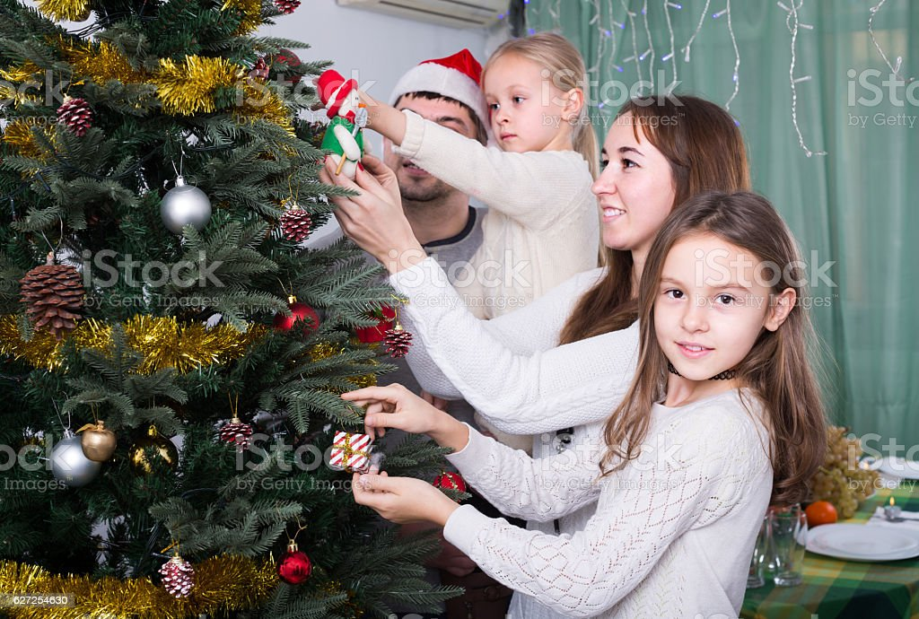 people decorating christmas tree royalty free stock photo - People Decorating A Christmas Tree