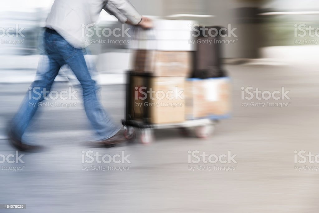 people delivery goods with dolly stock photo
