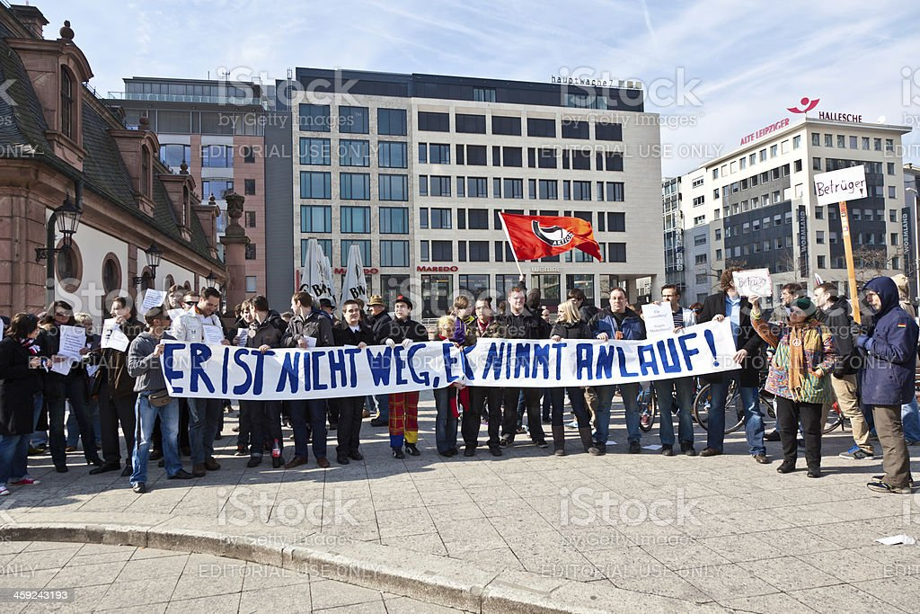 People demonstrate for return of Karl Theodor zu Guttenberg into stock photo