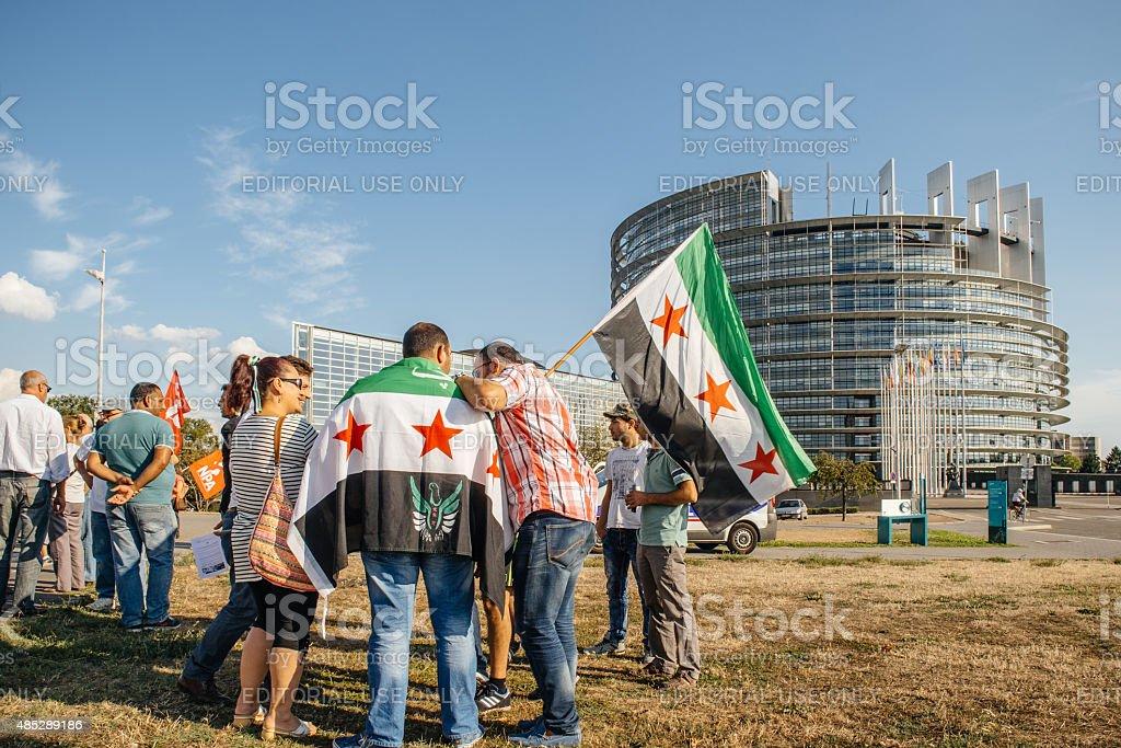 People denouncing the Syrian airstrikes on Douma stock photo