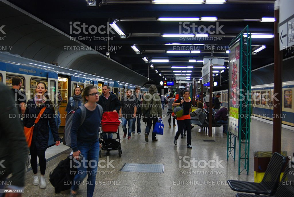 People depart subway train at station stock photo