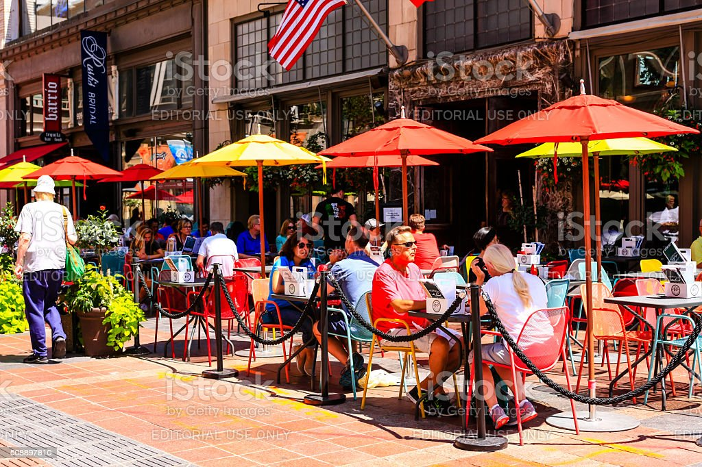 People dining outside a restaurant Nicollet Mall in Minneapolis MN stock photo