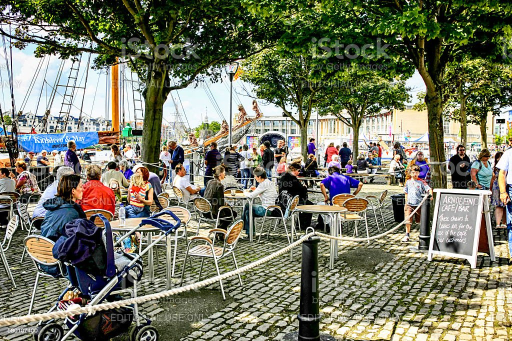 People dining outside in the docklands area of Bristol, UK stock photo