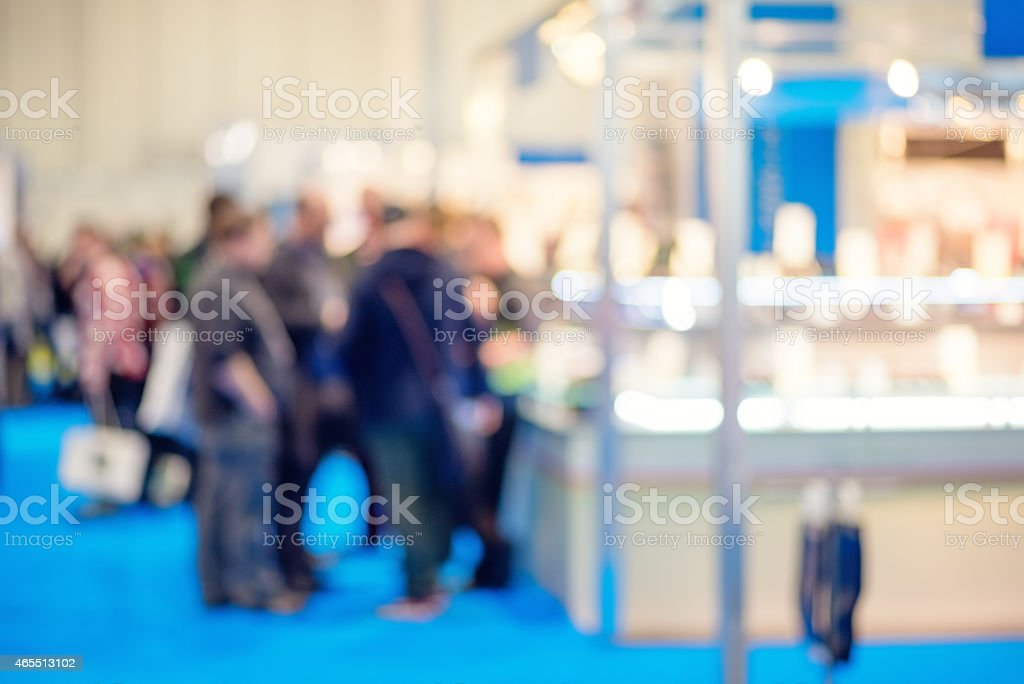 People Discussing a Product at a Trade Show stock photo