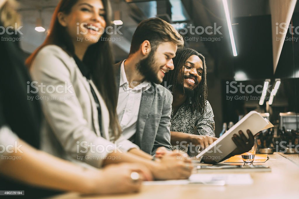 People discussing article in a pub stock photo